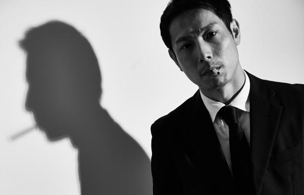 部長刑事(くわえ煙草伝兵衛)役 小川智之