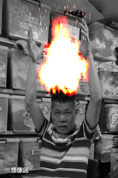 頭に乗せたポップコーンが炎上した際の梅垣義明(※想像図)